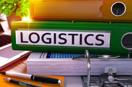 55177209 - green office folder with inscription logistics on office desktop with office supplies and modern laptop. logistics business concept on blurred background. logistics - toned image. 3d.