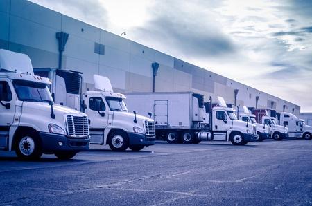 33002569 - trucks lorries loading unloading depot warehouse